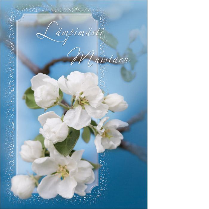 Kannessa sinisellä taustalla kukkivan omenapuun oksa ja teksti Lämpimästi muistaen.