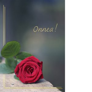 Kannessa punainen ruusu puisella tasolla sekä kultafolioinnilla teksti Onnea.